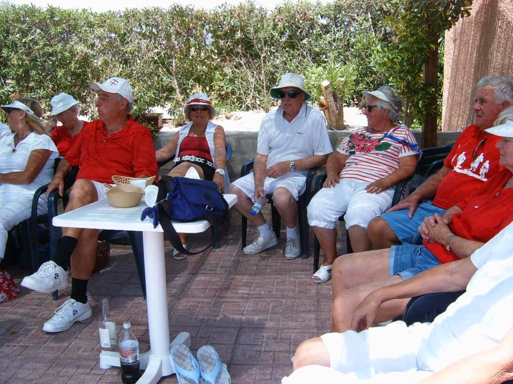 Members relaxing on the bowling patio